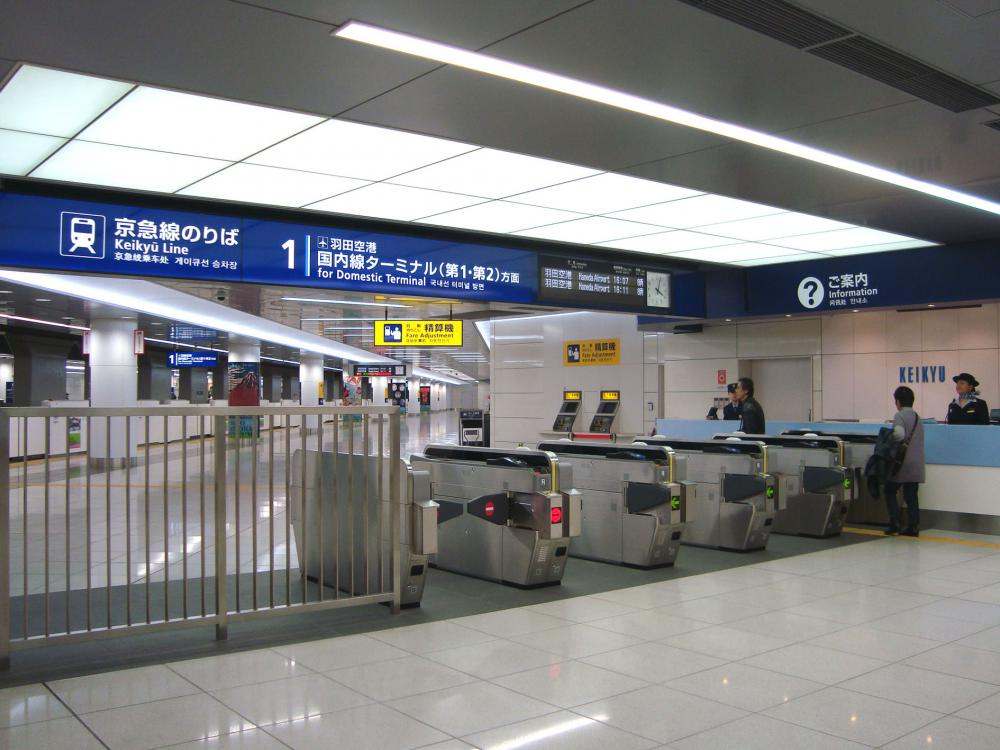 "Wide view open counter ticket gates and integrated ""train departure information"" into the gate sign"